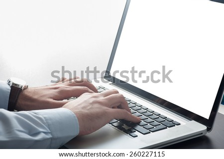 Businessman working in front of a laptop computer