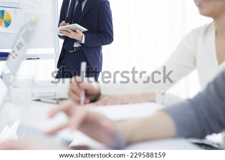 Businessman working in office - stock photo