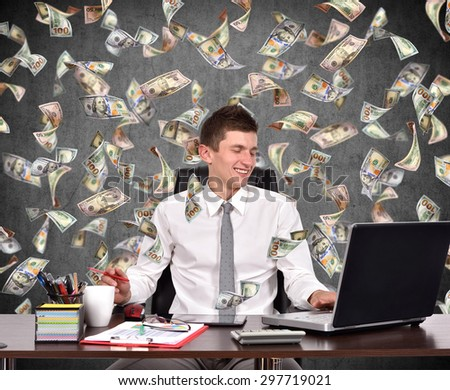 businessman working in office and falling dollar bills - stock photo