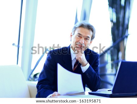 businessman working in office, sitting at desk - stock photo