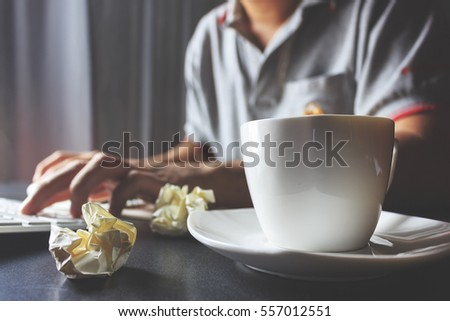 businessman working in office. soft-focus in the background. over sunlight