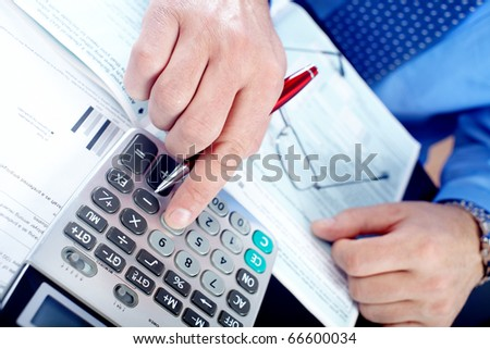 Businessman working in the office - stock photo