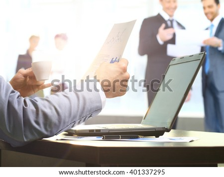 Businessman working in the office. early in the morning - stock photo