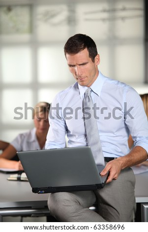 Businessman working in the office with laptop