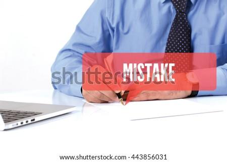 BUSINESSMAN WORKING OFFICE  MISTAKE COMMUNICATION SPEECH BUBBLE CONCEPT - stock photo