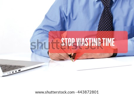 BUSINESSMAN WORKING OFFICE  STOP WASTING TIME COMMUNICATION SPEECH BUBBLE CONCEPT - stock photo