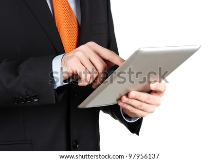 Businessman working on a digital tablet isolated on white