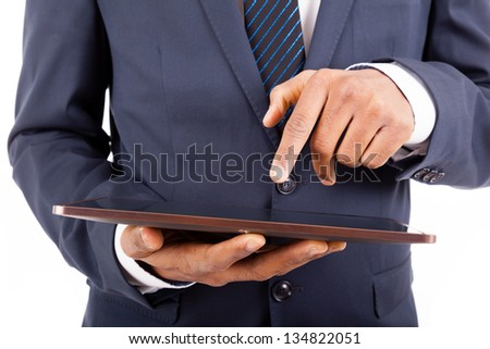 Businessman working on a digital tablet, isolated on white background - stock photo
