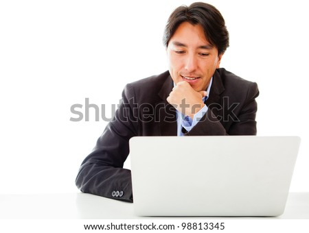 Businessman working on a laptop - isolated over a white background - stock photo