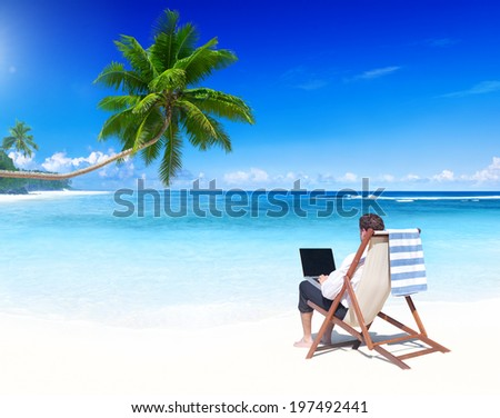 Businessman working on a tropical beach. - stock photo