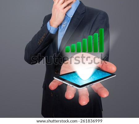 Businessman working on chart, business concept.Touch-pad visual screen. Isolated on grey. Stock Photo - stock photo