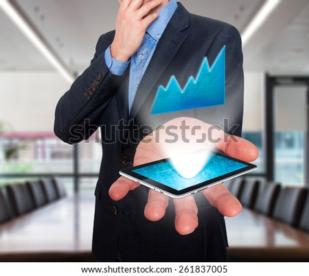 Businessman working on chart, business concept.Touch-pad visual screen. Isolated on office. Stock Photo - stock photo