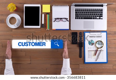 Businessman working on desk - CUSTOMER concept - stock photo