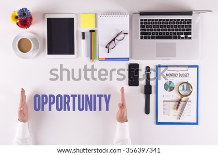 Businessman working on desk - hands showing OPPORTUNITY concept - stock photo