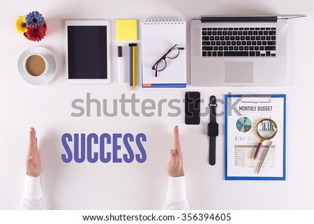 Businessman working on desk - hands showing SUCCESS concept - stock photo