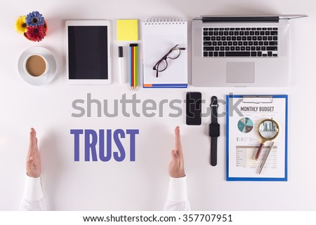 Businessman working on desk - hands showing TRUST concept - stock photo