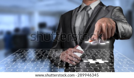businessman working on digital jigsaw screen, business strategy concept - stock photo