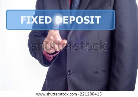 Businessman working on digital virtual screen press on button Fixed Deposit - stock photo