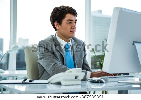 Businessman working on his computer in an office