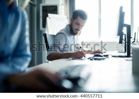 Businessman working on his desk in an office. - stock photo