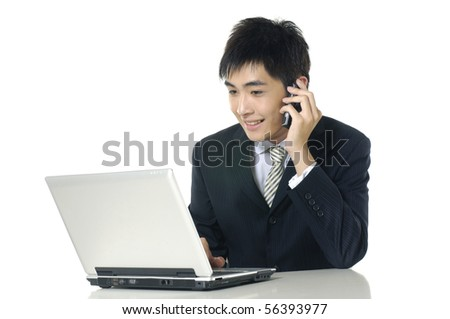 Businessman working on laptop and calling on phone, - stock photo