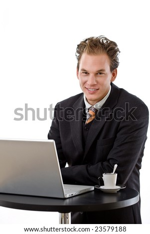 Businessman working on laptop at coffee table, white background.