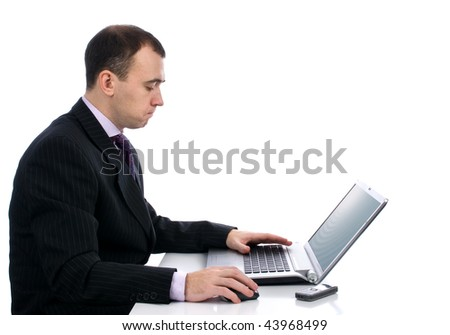 Businessman working on laptop computer. Isolated over white