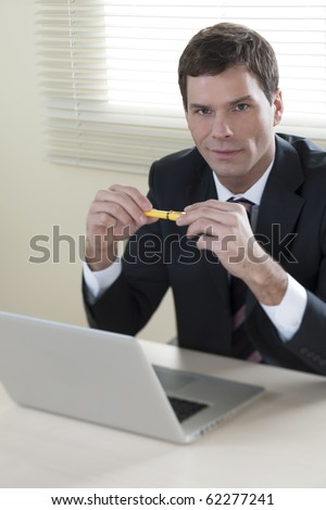 Businessman working on laptop in his office - stock photo