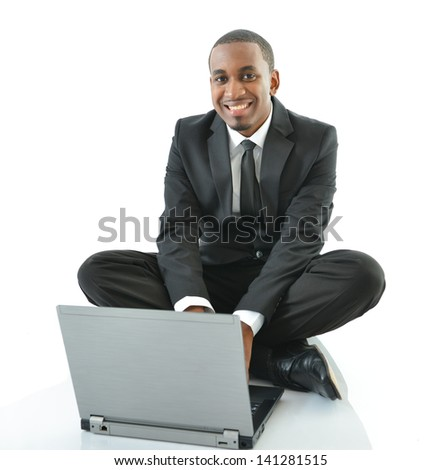 Businessman working on laptop sitting on floor - stock photo