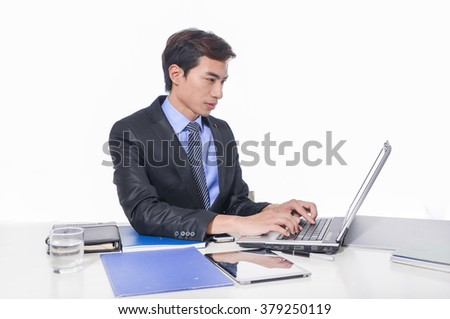 businessman working on laptop, young business man happy smile sitting at the desk, - stock photo