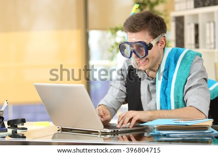 Businessman working on line or searching travel destinations with goggles needing vacations at office - stock photo