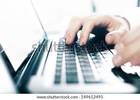 businessman working on notebook, closeup - stock photo