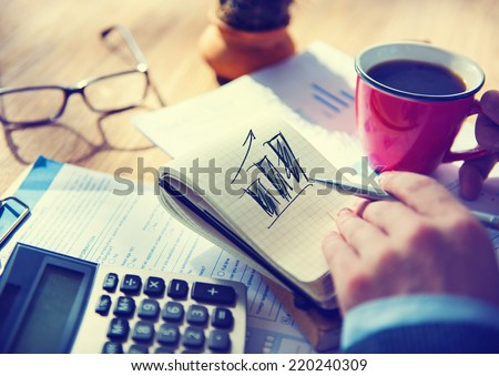 Businessman Working on Project About Business Growth - stock photo