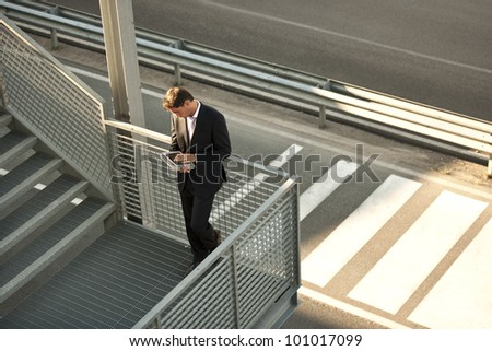 Businessman working on themove with his PC tablet - stock photo