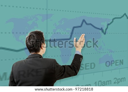 businessman working on touch screen and graph - stock photo