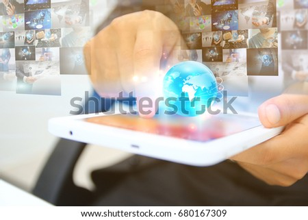 Businessman working on virtual screen.