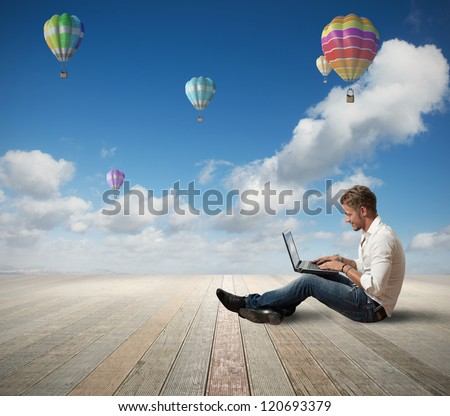 Businessman working outdoor with a laptop - stock photo