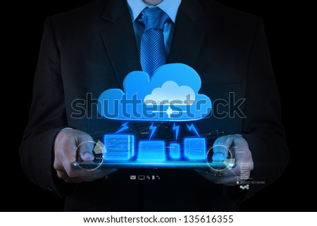 Businessman working with a Cloud Computing diagram on the new tablet computer interface - stock photo
