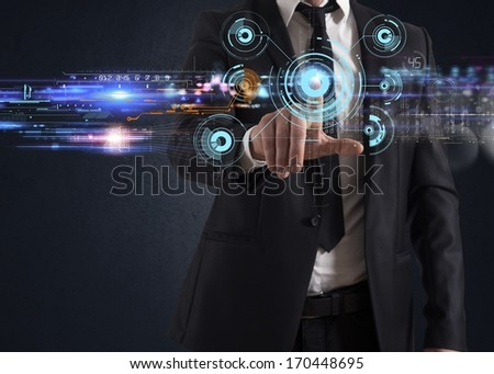 Businessman working with a futuristic touch screen interface - stock photo