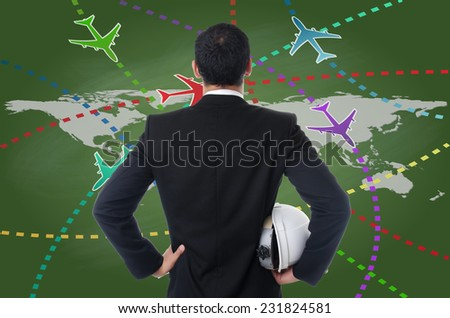 Businessman working with Airplane travel around the city on the blackboard. - stock photo