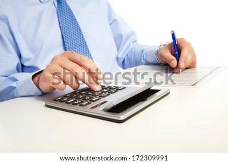 Businessman working with calculator in the office - stock photo