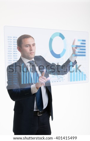 Businessman working with charts hologram - stock photo