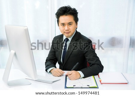 businessman working with desktop computer