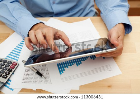 Businessman working with digital tablet. - stock photo