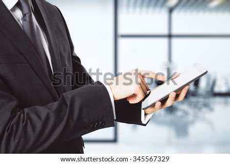 Businessman working with digital tablet in the office - stock photo
