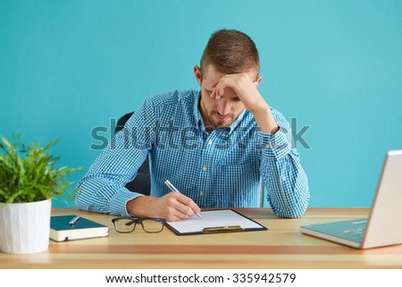 Businessman working with documents and laptop