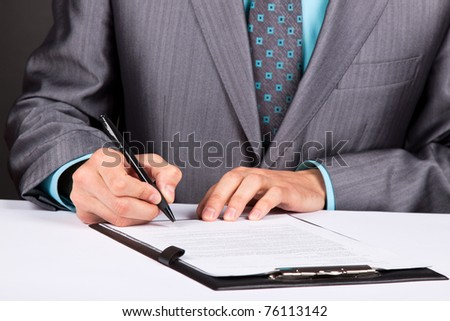Businessman working with documents sign up contract - stock photo