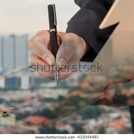 Businessman working with documents sign up contract.City background, Double exposure. - stock photo