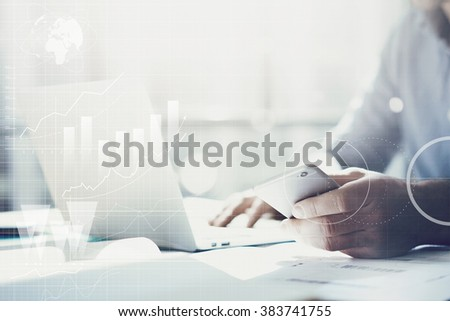 Businessman working with generic design notebook. Holding smartphone in hands. Worldwide connection technology interface  - stock photo
