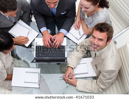 Businessman working with his colleagues in an office